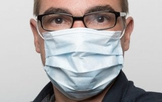 man wearing disposable face mask